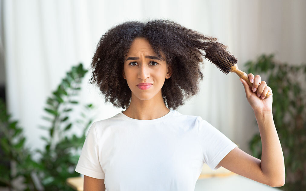 Why Women Experience Thinning Hair: Causes & Treatment